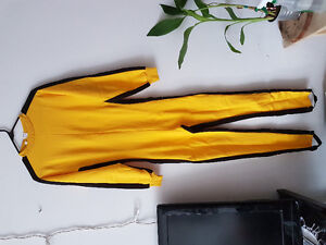 Bruce Lee martial arts suit with hand wraps