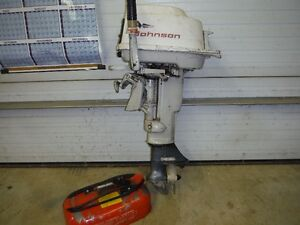 10 HP Johnson outboard motor and fuel tank