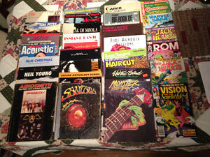 box of guitar books and old comics