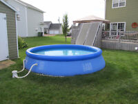 """12' Pool For Sale 24"""" deep comes with pump Good working order"""