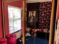 Huge double mirrored sliding door wardrobe from Harvey's