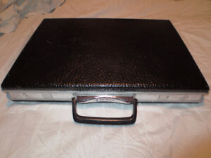 Thin black Samsonite suitcase hardshell