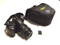 Nikon D3000 with 18-55mm VR kit lens, 4GB SD card and bag