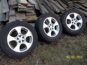 SUBRU ALUMINIUM RIMS (3) AND TIRES BRIDGESTONE