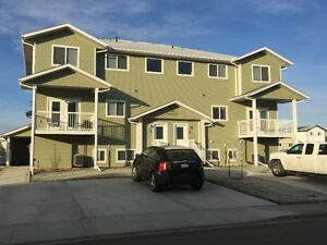 BROOKS, AB BEAUTIFUL, UPSCALE 3 BEDS/3 BATHS CONDO NOW AVAILABLE