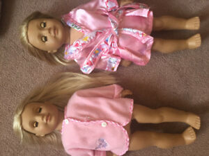 Two American girl dolls and many clothing items for them