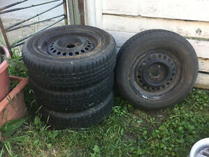 4 Tires on Rims and 4 Hubcabs