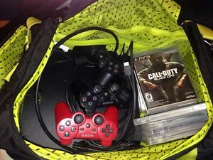 PS3 with games and 3 controllers