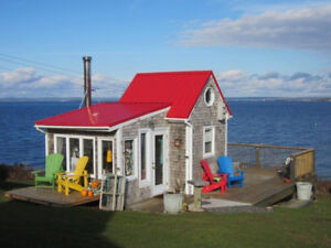 For sale cottage and land with 76' ocean frontage