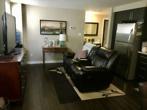 Bright 2 Bedroom unit in Duplex with garage and private yard!