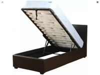 Black faux leather ottoman bed