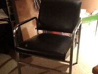 Black vinyl accent chair with Chrome