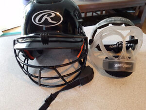 Female softball batting helmet with cage and fielding mask.