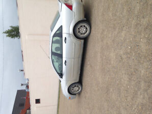 2004 Ford Focus 4 door  2 sets of tires low kms