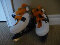 Adjustable skates. Child size 9-13