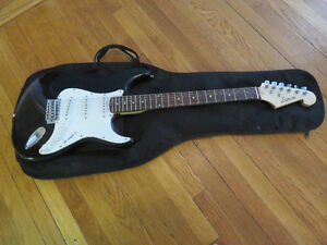 Electric guitar, amp and soft case