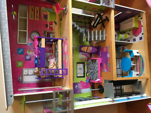 Barbie house with accessories and barbies