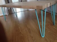 Solid oak coffee table with hairpin legs.