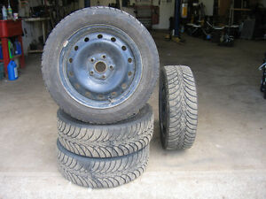 Goodyear Ultra Grip Ice tires with rims