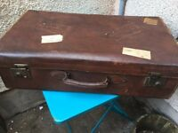 Large vintage leather suitcase. Shop display?