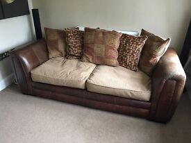 Leather and material settee,