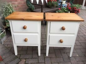 A PAIR OF IKEA WHITE BEDSIDE CUPBOARDS