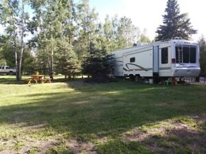 Acreage, rv lot, pond and creek with all services. 1 hour to ed.