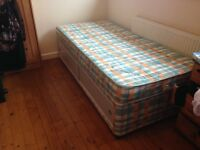 Single divan bed with sliding doors for storage. £55 ono. Never slept in.