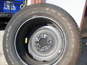 1996 Grand Marquis Spare Tire on 5 bolt steel Rim