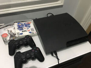 PS3 Slim with 2 wireless controllers and games 150obo