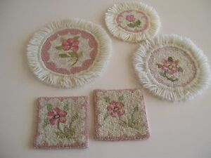 HOOKED WOOL COASTERS AND DOILIES