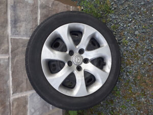Mazda 3 rims, tires and wheel cover's x4