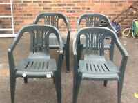 4 green plastic garden chairs Good condition