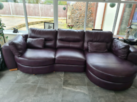 Used plum leather sofa