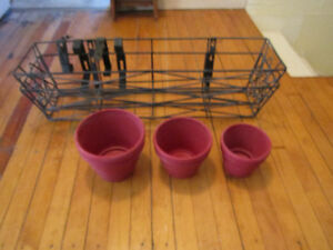 TWO WROUGHT IRON PLANT BASKETS WITH THREE CLAY POTS