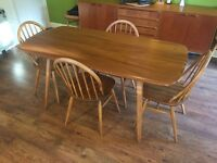 Vintage Ercol no 382 plank dinning table and 4 Ercol chairs.
