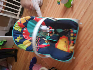 Baby rocking seat with toy attachment