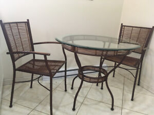 Like new Beautiful kitchen  glass top table tan wicker chairs