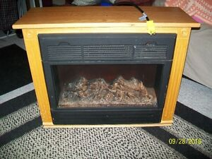 FIREPLACE electric 2 feet high. works great! $125.00 OBO Kitchener / Waterloo Kitchener Area image 1