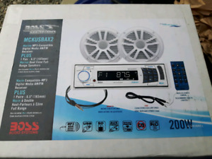 Brand new in box boss marine audio deck and speakers 130$ obo