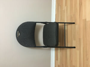 Excellent condition chair in fabric material.
