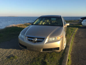 2004 Acura TL (all season and winter tires on rims incl)
