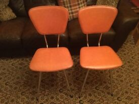 A Pair Of Retro vintage kitchen chairs