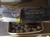 Three boxes of golf balls and box of tees