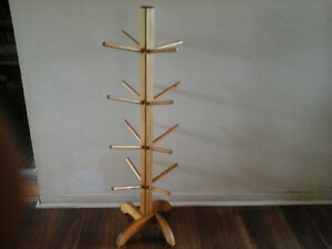 "Solid wood stand with 16 secure pegs. 40"" tall. Great condition."