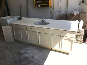 Oak cabinet, sink, taps and countertop