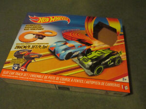 Hot wheels race track with box and two cars