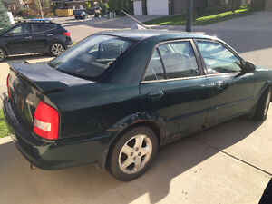 2002 Mazda Protege with only 141000km price drop $595