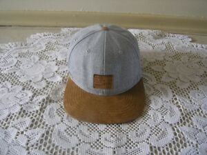 H & M GREY AND TAN CAP - ONE SIZE - NEW CONDITION
