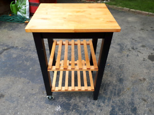 Moveable butcher block table/cart.